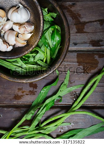 Morning glory, beans and garlic in wooden bowls. Vegetarian food