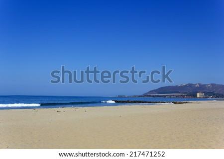 Morning hour on empty sandy beach, City of San Buenaventura, California - stock photo