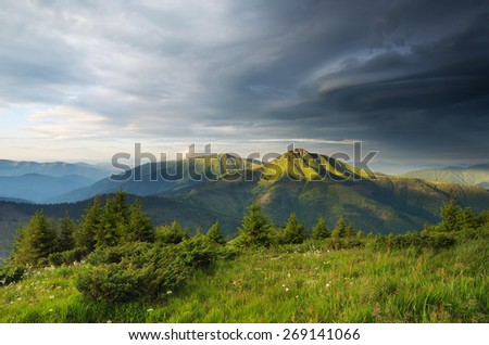 Morning in the mountains. Summer landscape. Spruce forest on the mountain slopes. Sky with beautiful clouds - stock photo