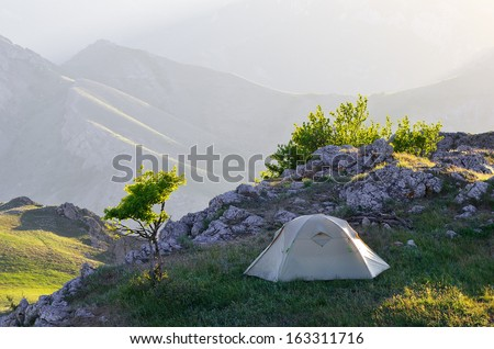 Morning landscape with a tent. Camping in the Spring Mountains - stock photo