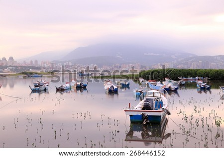 Morning landscape with abandoned boats on Tamsui river, Taipei Taiwan - stock photo