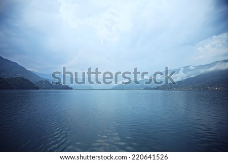 Morning landscape with lake and mountains. Pokhara, Nepal - stock photo