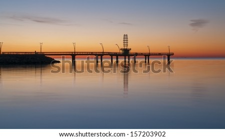 Morning light on a pier over lake Ontario - stock photo