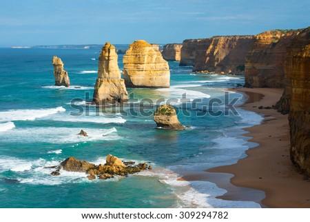 Morning light on the landmark Twelve Apostles along the Great Ocean Road in Victoria, Australia - stock photo