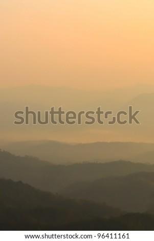 Morning mist and layers of tropical mountain at Huai Nam Dang National Park in Mae Hong Son, Thailand - stock photo