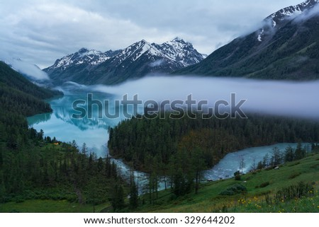 Morning mist over a Large Kucherlinskoye lake, Katun ridge, Altai mountains