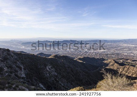 Morning mountaintop view towards Burbank, Griffith Park and Los Angeles, California - stock photo