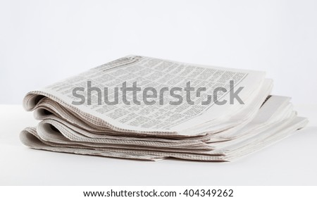 Morning newspapers on the table, closeup shot