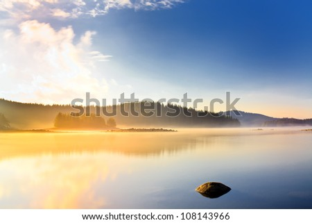 morning on the mountain lake - stock photo
