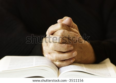 morning prayer (special toned photo f/x, focus point on hands (selective)) - stock photo