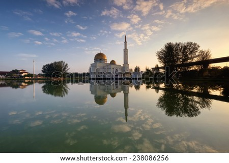 Morning scenery of As-Salam mosque in Puchong, Malaysia with nice reflection from the calm lake.