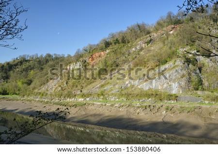Morning Sun on Limestone Cliffs of West Side of Avon Gorge, Bristol - stock photo