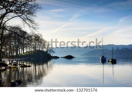 Morning sunlight on Lake Windermere - stock photo