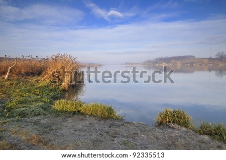 Morning sunlight over the lake - stock photo