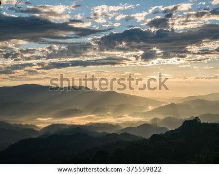 Morning sunlight shines on mountain ranges in Northern Thailand