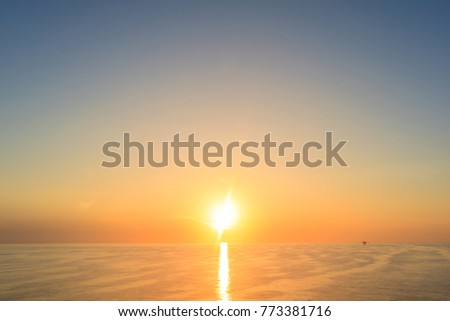 Morning sunrise in warm color with clearly sea and sky in gulf of Thailand.