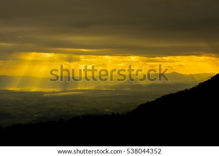 Morning sunrise with warmly cloud and mountain.