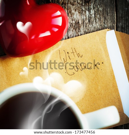 Morning Tea with Steam in the Shape of Heart and Message With Love - stock photo