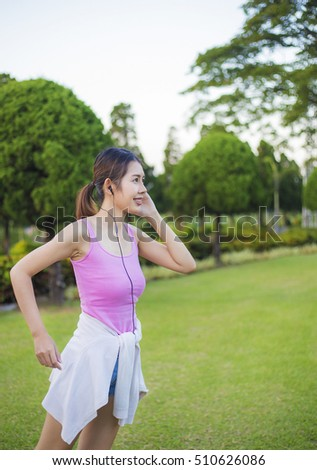 Morning the Asia women beautiful model health care show yoga slender is smile on the garden . shirts is pink, background
