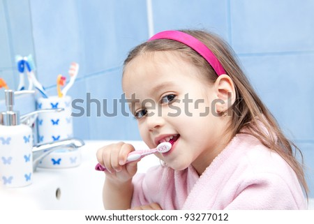 morning tooth wash, smile girl in bathroom - stock photo