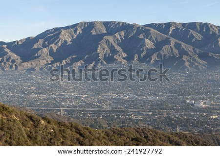 Morning valley haze at La Crescenta and Montrose below Mt. Lukins near Los Angeles in Southern California. - stock photo
