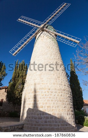Morning view of Ancient Windmill in Old Jerusalem,The Montefiore Windmill (less-commonly known as the Jaffa Gate Mill), Israel. - stock photo