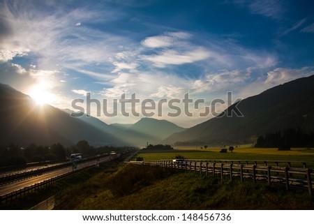 morning view of Autobahn in Italy, Dolomites near Austria border - stock photo