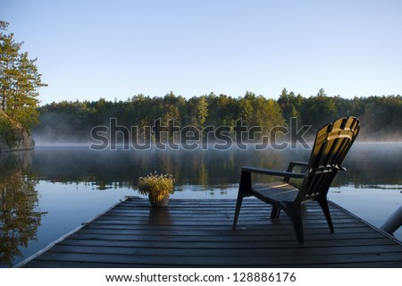 Morning view of the bay from the dock at the lake - stock photo