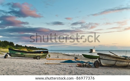 Morning view on the beach with facilities of collective fishing company, Gulf of Riga, Baltic Sea, Latvia - stock photo
