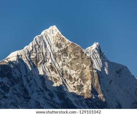 Morning view the peaks Kantega (6783 m) and Thamserku (6608 m) from Tengboche monastery - Nepal, Himalayas - stock photo