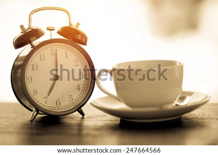 Morning vintage coffee with alarm clock. - stock photo