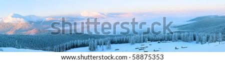Morning winter calm mountain panorama with sheds group and mount ridge behind (Carpathian Mountains, Ukraine).  Nine shots stitch image. - stock photo