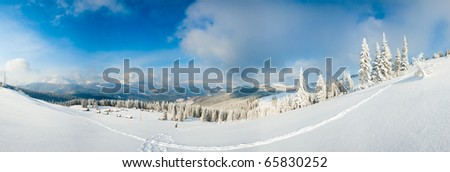 Morning winter calm mountain panorama with sheds group and mount ridge behind (Carpathian Mountains, Ukraine).  Six shots stitch image. - stock photo