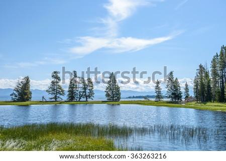 Morning Yellowstone Lake - A Summer day at Yellowstone Lake -- Gull Point, Yellowstone National Park, Wyoming, USA. - stock photo