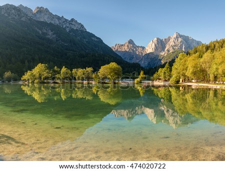 Morning yoga exercise at lake Jasna in Slovenia.
