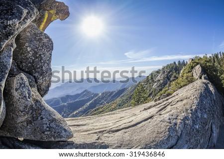 Moro Rock against sun, unique granite dome rock formation in Sequoia National Park, USA. - stock photo