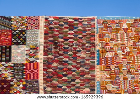 Moroccan carpets in the souks of Marrakesh - stock photo