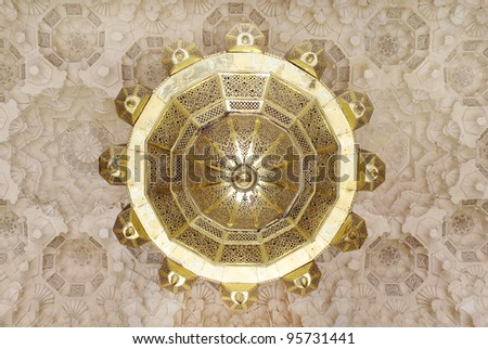 Moroccan ceiling lamp with traditional design on the ceiling - stock photo
