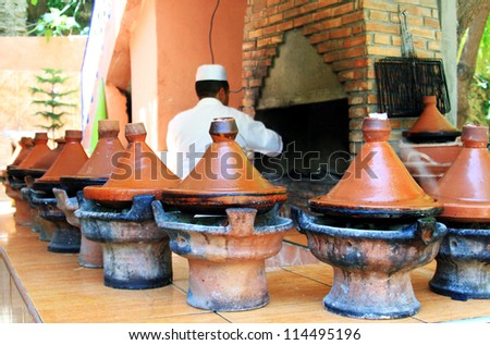 Moroccan ceramic cookware - tajines - stock photo