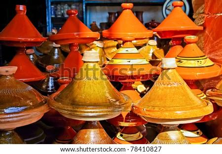 Moroccan ceramic cookware / tajines at the market - stock photo