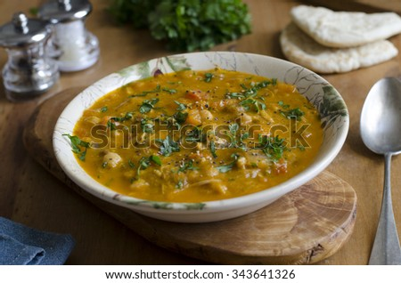 Moroccan chicken soup with chickpeas, sultanas and spices - stock photo