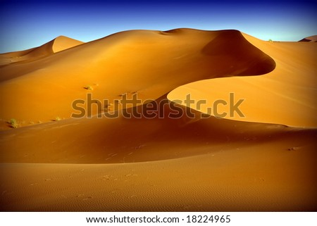 Moroccan desert dune background 09. Blue sky - stock photo