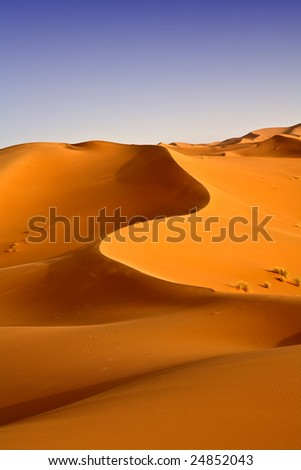 Moroccan desert dunes landscape background 11. Blue sky - stock photo