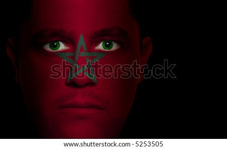 Moroccan flag painted/projected onto a man's face.