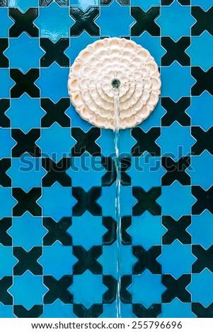 Moroccan fountain with mosaic tiles. Moroccan fountain. - stock photo