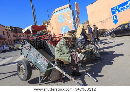 Moroccan men rest in a trolley in marrakesh. MARRAKESH, MOROCCO, february 24, 2015 - stock photo