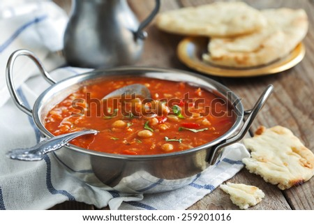 Moroccan soup with chickpeas. Selective focus on soup in bowl - stock photo