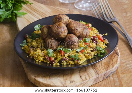 Moroccan spiced falafels with couscous on a plate - stock photo