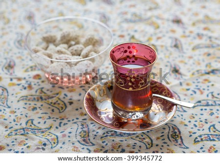 Moroccan tea cup with nuts - stock photo