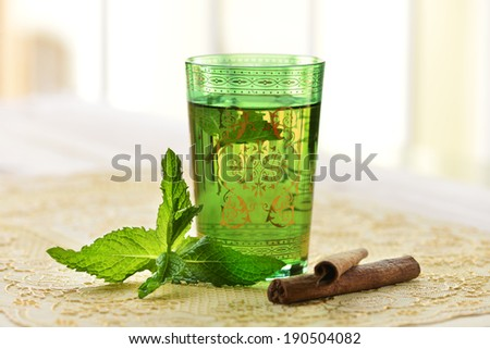Moroccan tea with mint leaves and cinnamon - stock photo